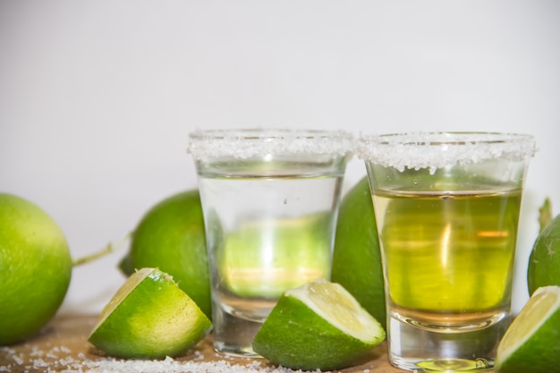 Tequila glasses with lemon and typical salt from mexico