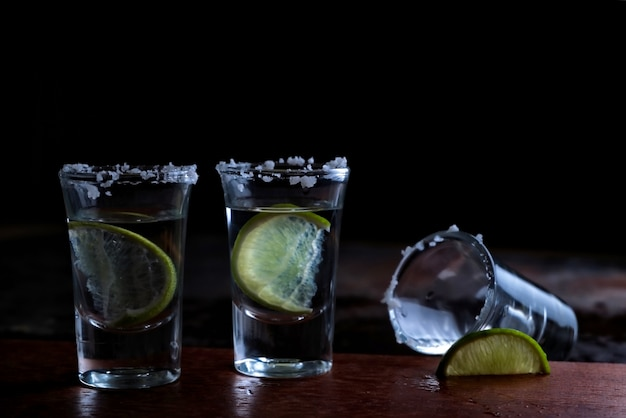 Tequila shot glasses with salt and lime