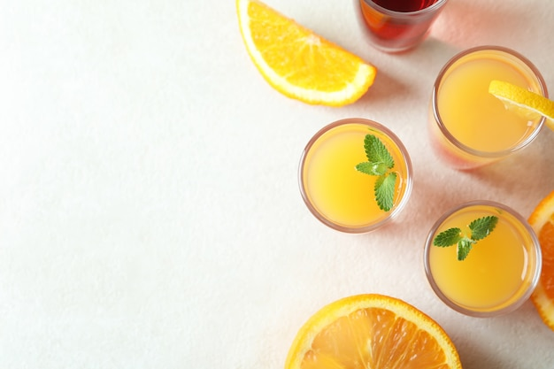 Tequila sunrise cocktails on white textured background, top view