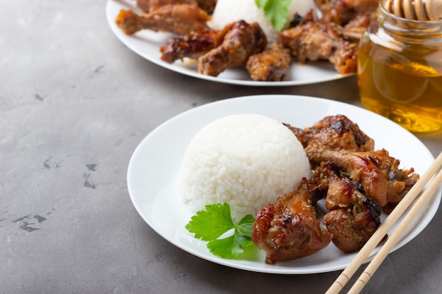 Teriyaki chicken with rice on gray background