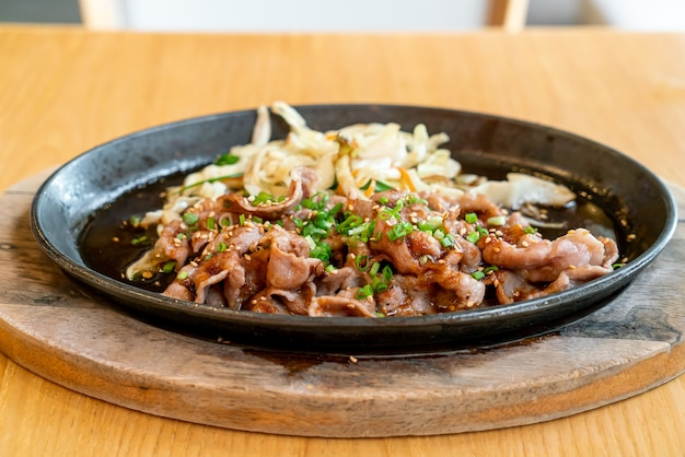 Teriyaki pork in hot pan with cabbage - japanese food style