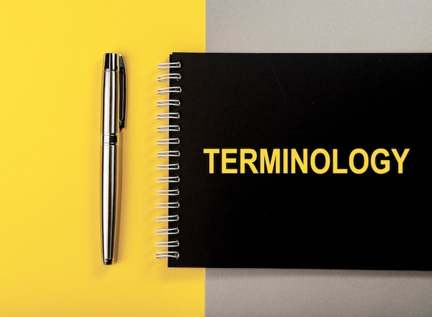 Terminology word on black notebook top view