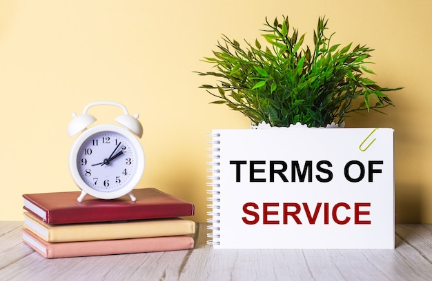 Terms of service written on white paper on a light brown background