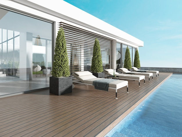 Terrace by the pool with sun loungers near the modern house. 3d rendering