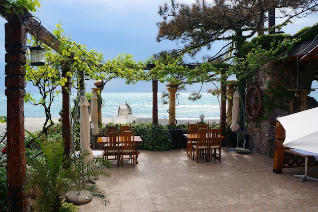 Terrace cafe by the sea in the mediterranean style