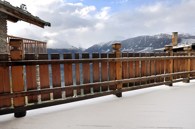 Terrace of a cottage with snow