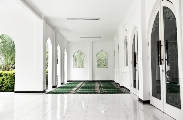 Terrace mosque interior with carpet and tiled floor