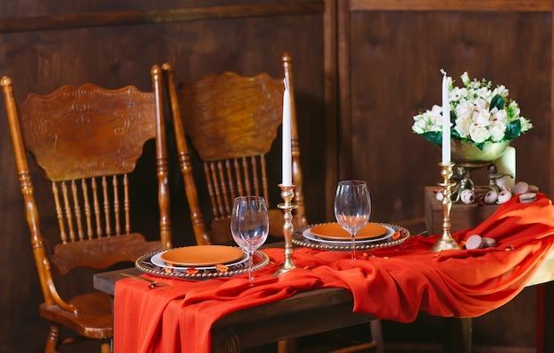 Terracotta color dinner table set.