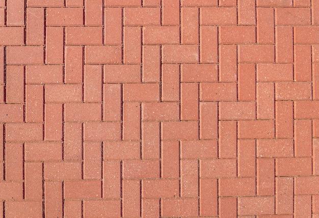 背景のテラコッタタイルの床。