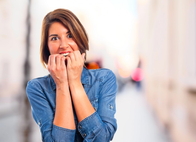 Terrified woman with hands in mouth