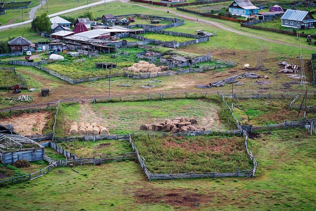 Territory and farm buildings of a livestock farm russia mountain altai village of bichiktuboom