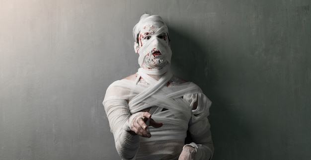 Terrorific mummy on textured wall background.  halloween holidays