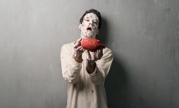 Terrorific zombie eating a heart.  halloween holidays