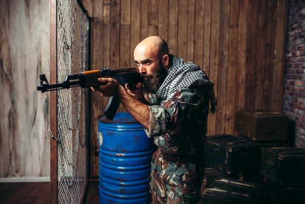 Terrorist aiming from a kalashnikov rifle