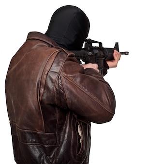 Terrorist portrait with rifle on white