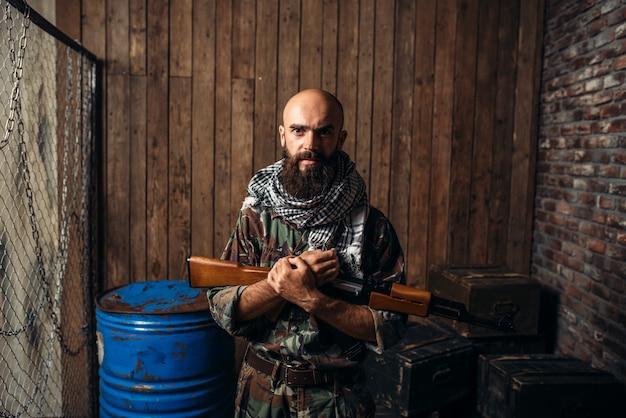 Terrorist in uniform holds kalashnikov rifle