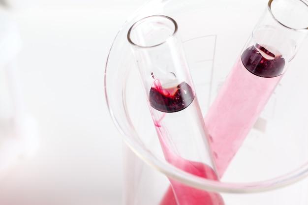 Test flasks with color samples on light grey background