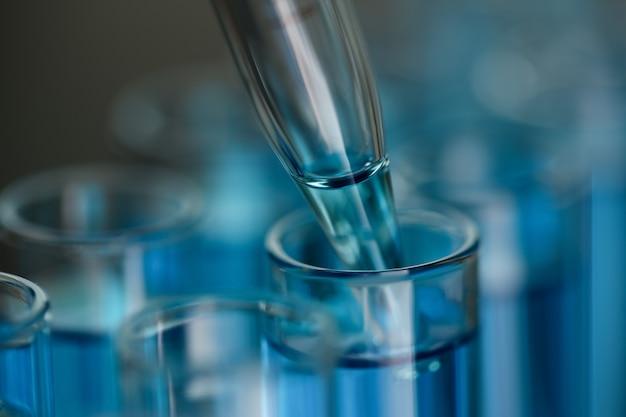 Test tube of glass overflows liquid solution potassium