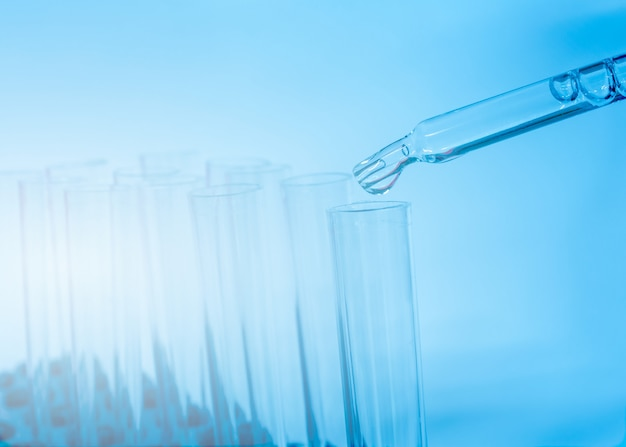 Test tube in the laboratory on a blue background