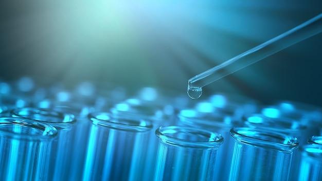 시험관 행. 의료 또는 과학 실험실의 개념, 파란색 배경에 스포이드가 있는 액체 방울, 클로즈업, 마이크로 사진 사진.