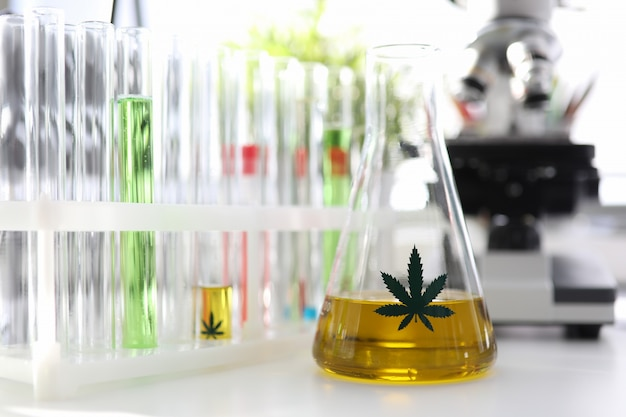 Test tube with yellow cbd oil in chemisrtry lab