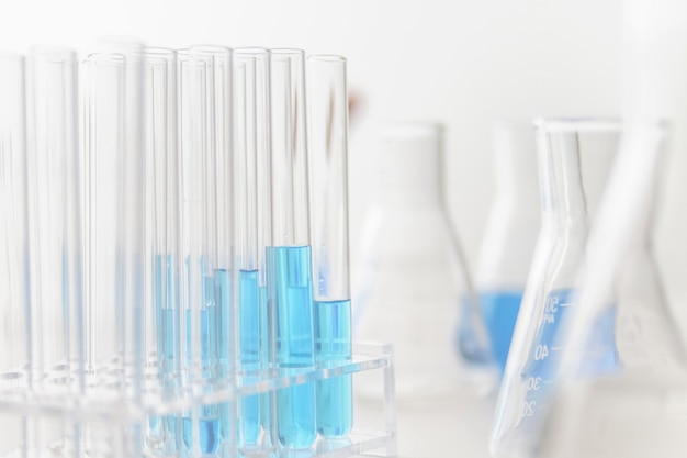 Test tubes and flasks with blue liquid in a laboratoy.