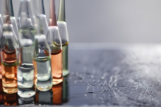 Test tubes with drugs and tests to test the victims and treat the infected. ampoules with medicines. set of test tubes with medicine.