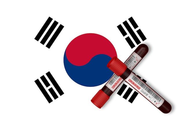 韓国国旗の背景に碑文2019-ncovの試験管。 3dレンダリング