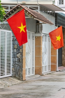 Tet holiday - national flag hung in front of houses in a street in the city of hanoi