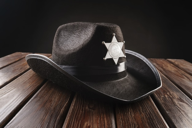 Texas police sheriff's hat in western style and revolver