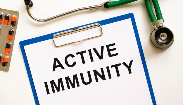 Text active immunity in the folder with the stethoscope