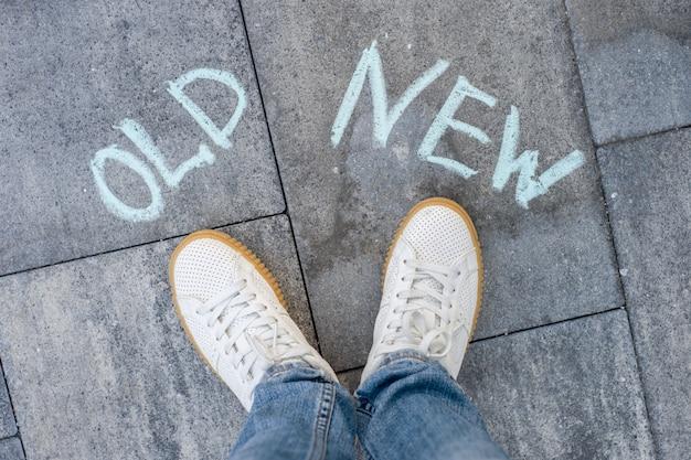 The text on the asphalt old - new, a choice