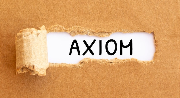 Text axiom appearing behind torn brown papertext culture appearing behind torn brown paper.