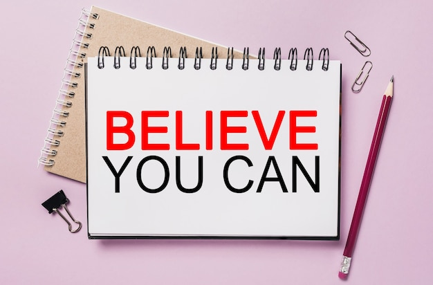 Text believe you can on a white notepad with office stationery space