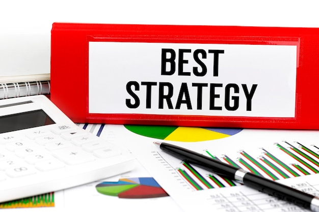 Text best strategy on red folder. business concept.