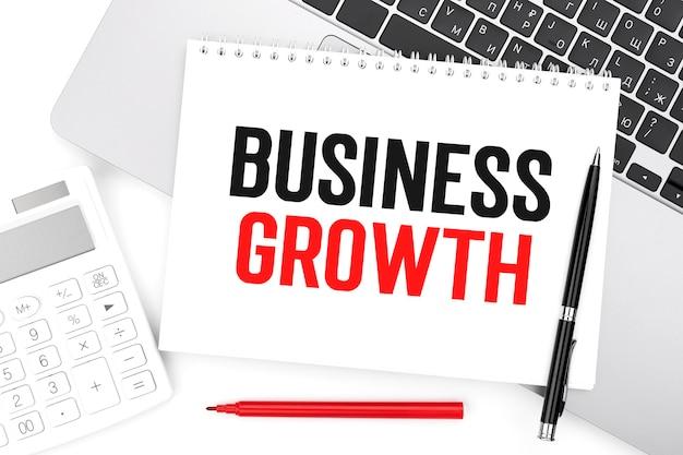 ノートブック、電卓、ラップトップでbusinessgrowthにテキストメッセージを送信します。ビジネスコンセプト。フラットレイ。