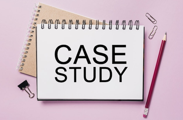 Text case study on a white notepad with office stationery space