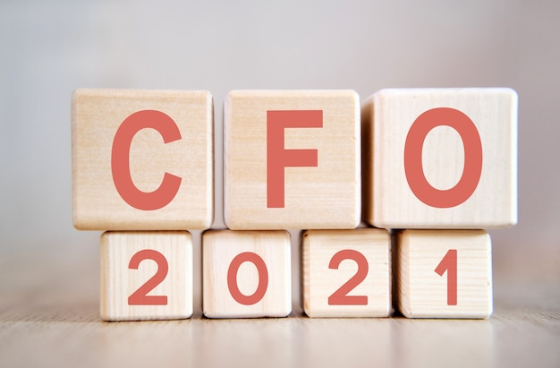 Text - cfo 2021 on wooden cubes, on wooden surface
