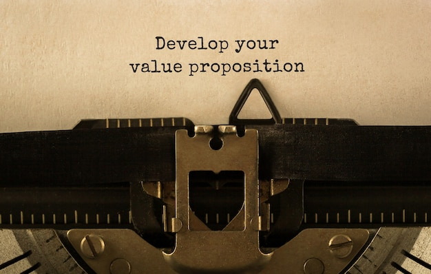 Text develop your value proposition typed on retro typewriter