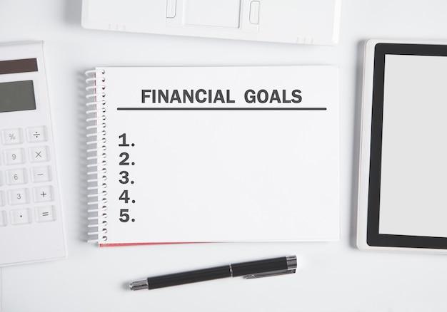 Text financial goals on notepad.