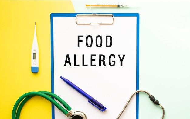 Text food allergy on a letterhead in a medical folder stethoscope