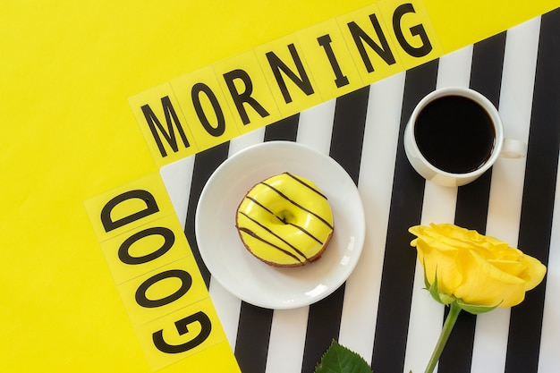 Text good morning, coffee, notebook for text on yellow