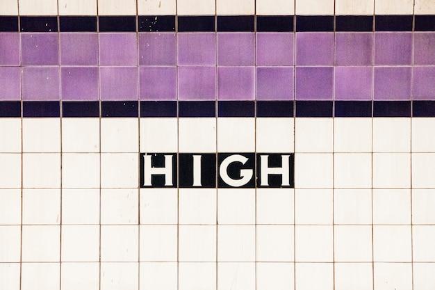 Text high on white tile