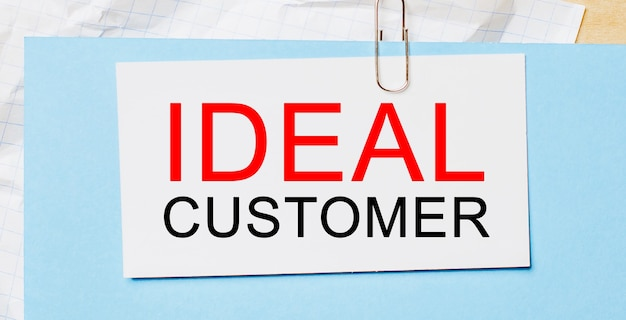 Text ideal customer on a white card on a blue background. business concept
