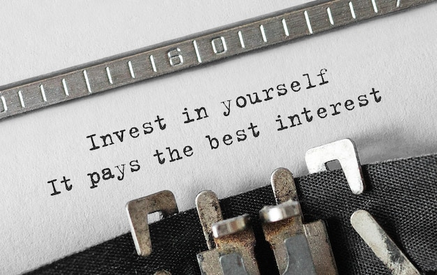 Text invest in yourself, it pays the best interest typeed on retro typewriter