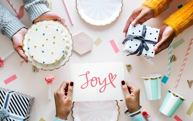 Text joy in a birthday party themed background