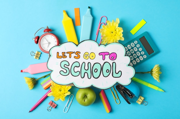 Text let's go to school and school supplies