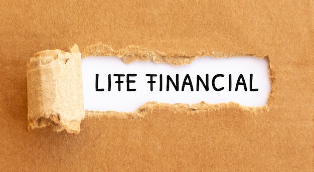 Text life financial appearing behind torn brown paper.