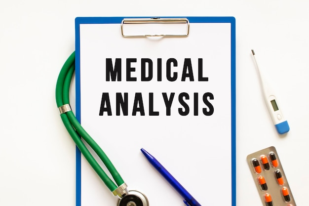 Text medical analysis in the folder with the stethoscope