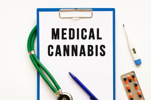 Text medical cannabis in the folder with the stethoscope.